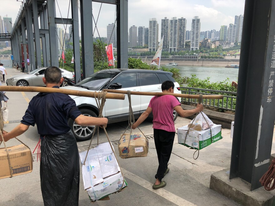 """Many of Chongqing's street porters known as """"bangbang"""" — which means """"stick-stick"""" men — were displaced amid the city's large-scale development."""