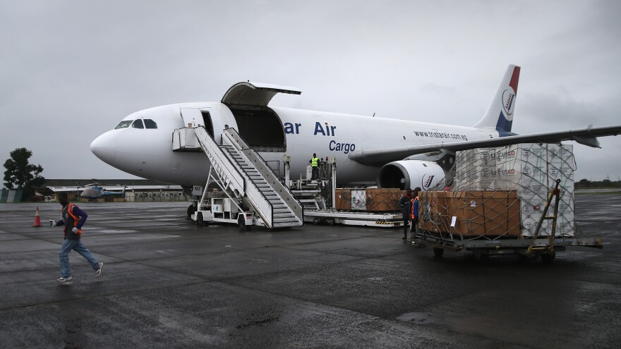 Workers unload medical supplies to fight the Ebola epidemic from a USAID cargo flight in Harbel, Liberia, in August.