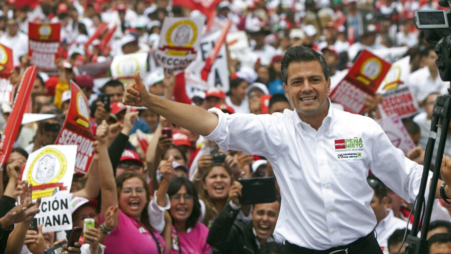 Mexican presidential front-runner Enrique Pena Nieto of the Institutional Revolutionary Party, or PRI, waves to the crowds during a campaign stop in the northern border city of Tijuana, Mexico, on June 3. The once dominant PRI, out of power for the past 12 years, looks likely to make a comeback.