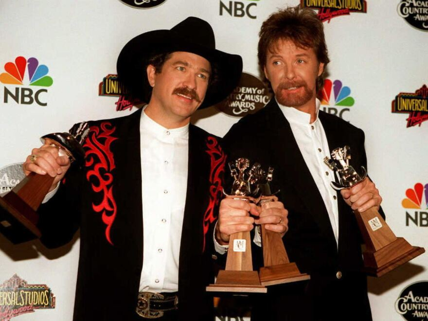 Kix Brooks (left) and Ronnie Dunn at the hold the awards they won during the 1996 Academy of Country Music Awards, where the duo won the award for Entertainer of the Year.