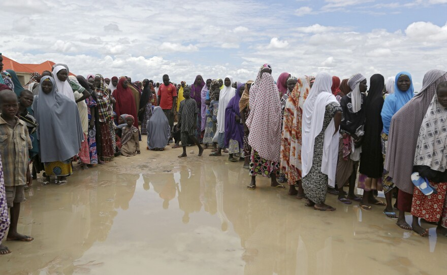 Women who say they have not been fed for five days line up for food in Aug. 2016 at the Bakassi camp in Maiduguri, Nigeria.