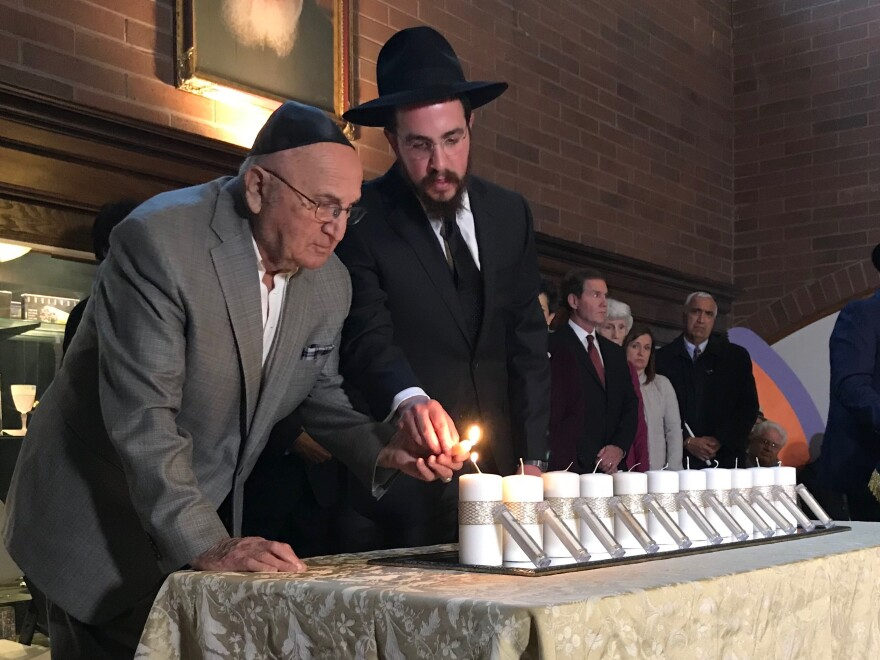 Photo of candles being lit