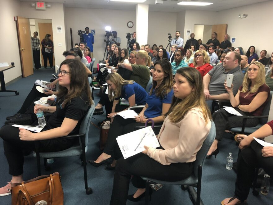 Providers and parents fill the room of AHCA's Tampa field office for a public meeting about proposed changes to behavior analysis therapy through Florida Medicaid. Future meetings will be held in webinar form.