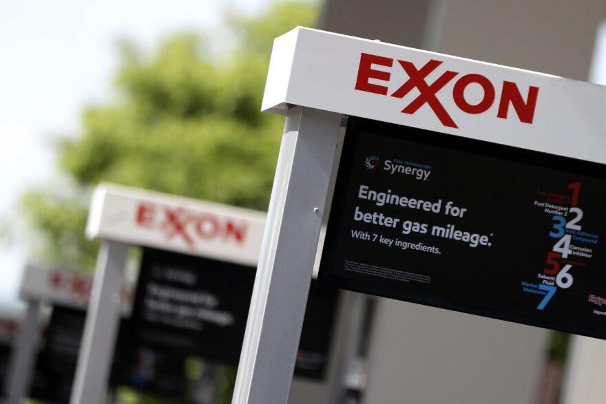 Exxon Mobil logos on gas station signs.