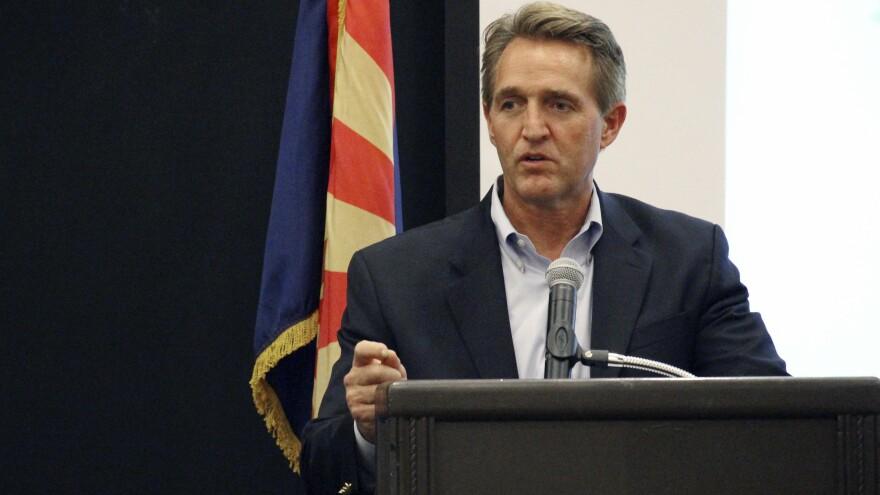 Sen. Jeff Flake, R-Ariz., addresses business officials gathered for an event in Prescott, Ariz., on Aug. 10.