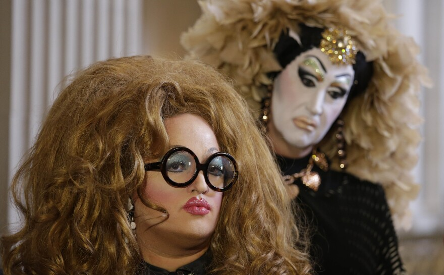 Drag queens Lil Miss Hot Mess (left) and Sister Roma join other activists for a news conference at San Francisco City Hall on Sept. 17 to speak out against Facebook's rule on using legal names for profiles.