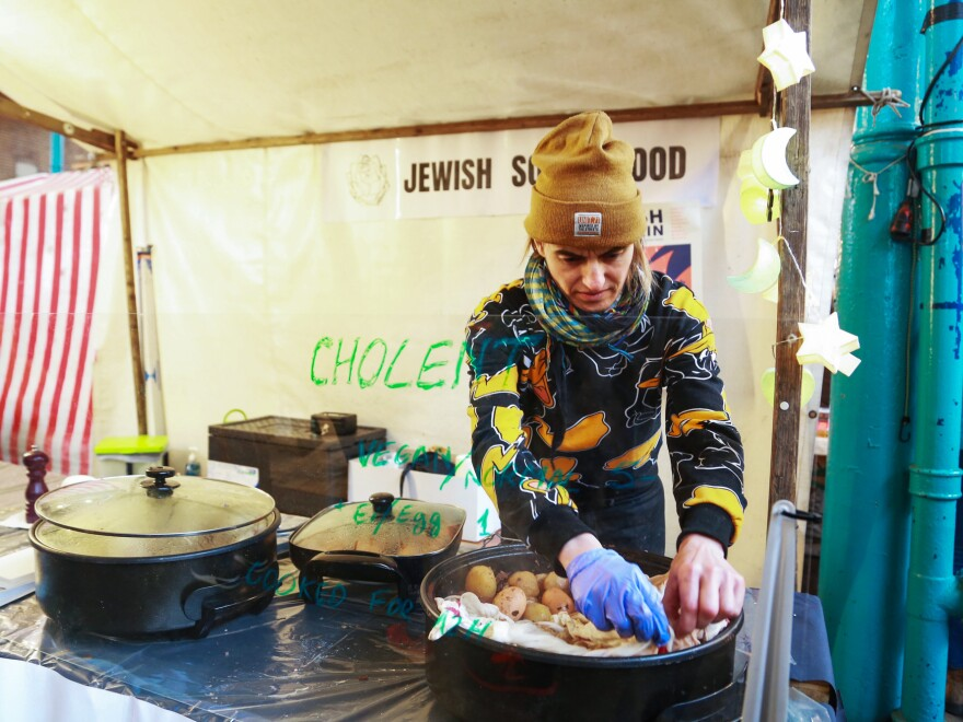 """One of the vendors at Berlin's food hall during Nosh Berlin, the German capital's first food week, sold <a href=""""http://www.npr.org/sections/thesalt/2014/02/22/280231765/cholent-the-original-slow-cooked-dish"""">cholent</a>, which he dubbed """"Jewish soul food."""" March 19, 2017"""