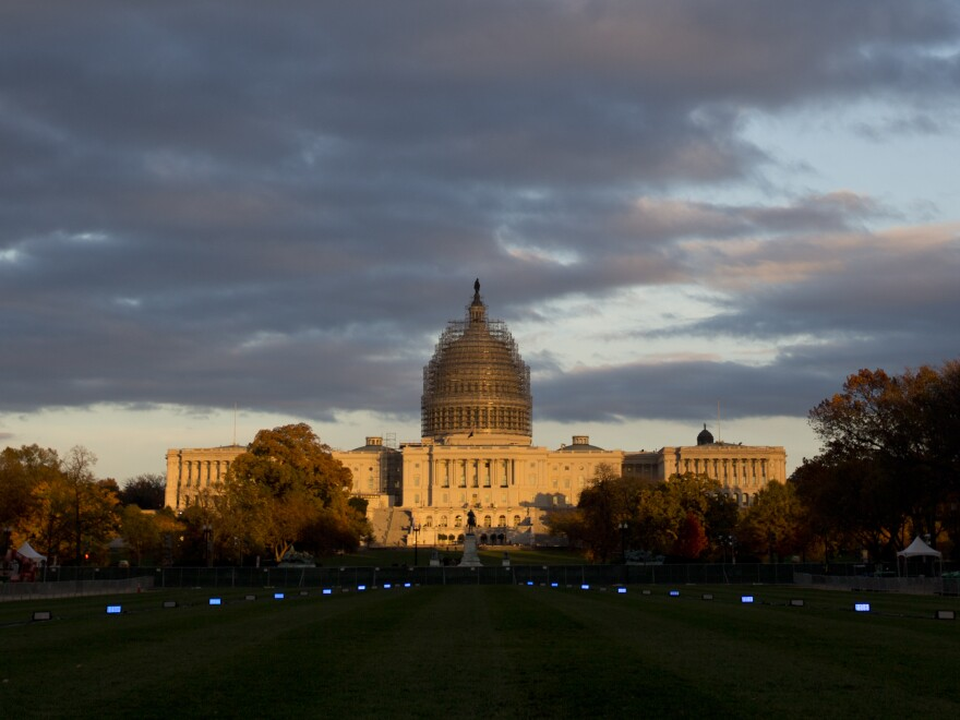 The sun sets on the U.S. Capitol Building on the National Mall in Washington. On January 6th, Republicans will take over both chambers for the 114th Congress.