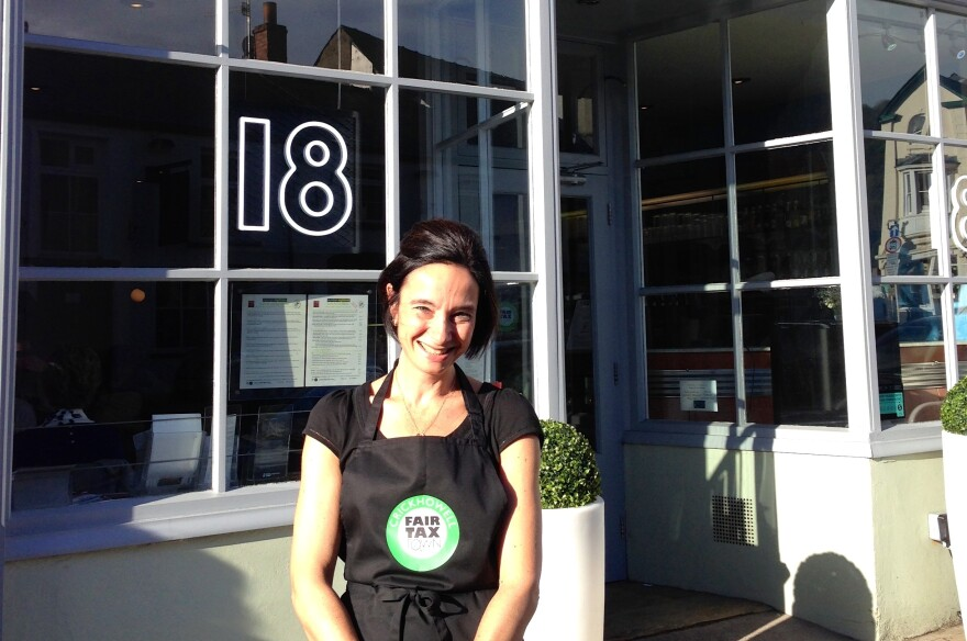 Samantha Devoss, the proprietor of Crickhowell's Number 18 coffee shop, helped organize the town's offshore tax scheme. If more towns did something similar,  the government would be forced to close loopholes used by big corporations, she believes.