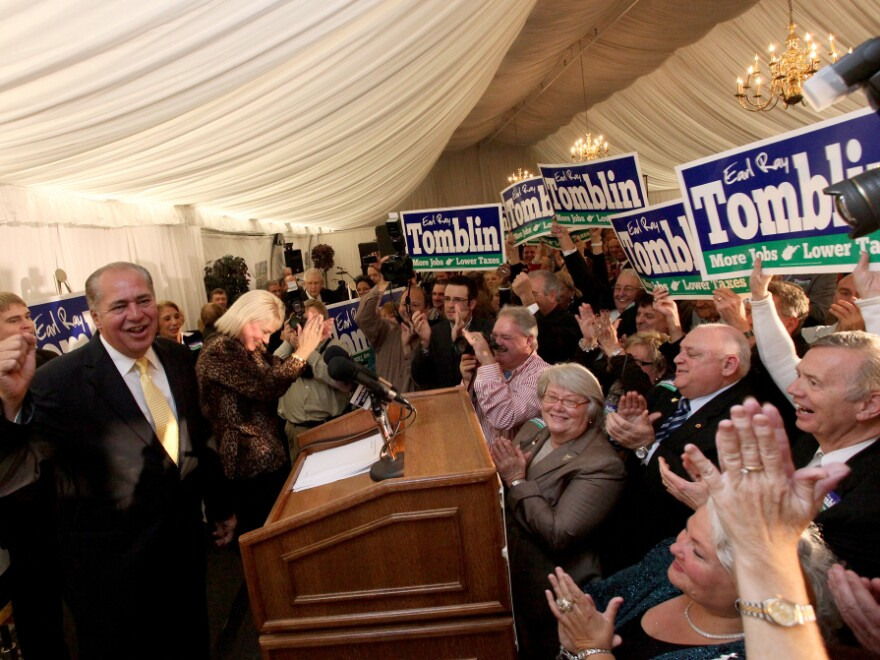 <p>W. Virginia acting-Gov. Earl Ray Tomblin raises fist in victory in  Charleston, W.Va., Tuesday, Oct. 4, 2011. </p>