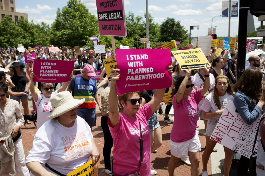 Abortion rights activists on Thursday gathered near the Gateway Arch to protest the potential closure of Missouri's only abortion provider. They marched to the Wainwright State Office Building, where some activists went inside. May 30, 2019