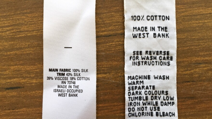 "When the lingerie factory was operating, the U.S. said that West Bank products could be marked ""Made in the Israeli Occupied West Bank"" (left).  European labels from that time marked Palestinian products ""Made in the West Bank."" The U.S. said that West Bank products could be marked ""Made in the Israeli Occupied West Bank"" (left). Old European labels say ""Made in the West Bank."""
