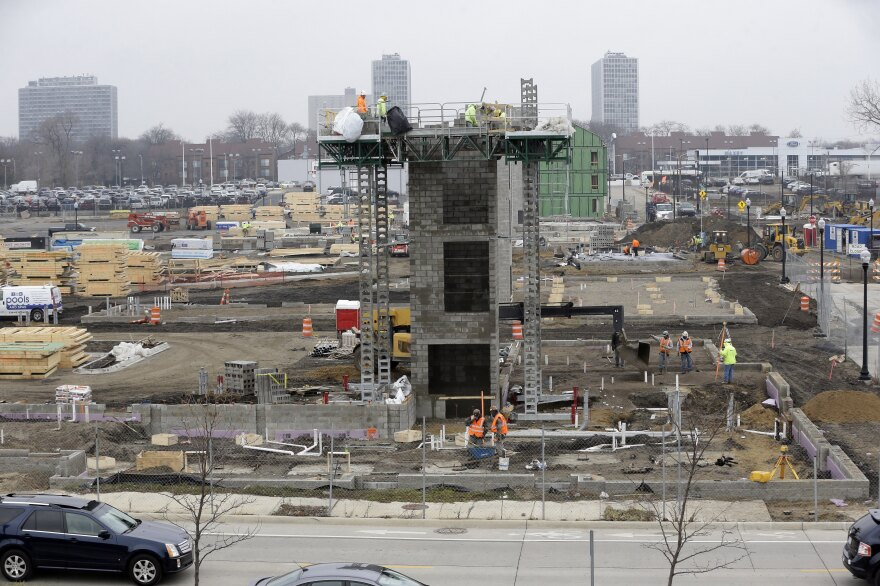 Construction continues on Orleans Landing, a housing development along the Detroit riverfront. A year after its exit from bankruptcy, new development is booming downtown.