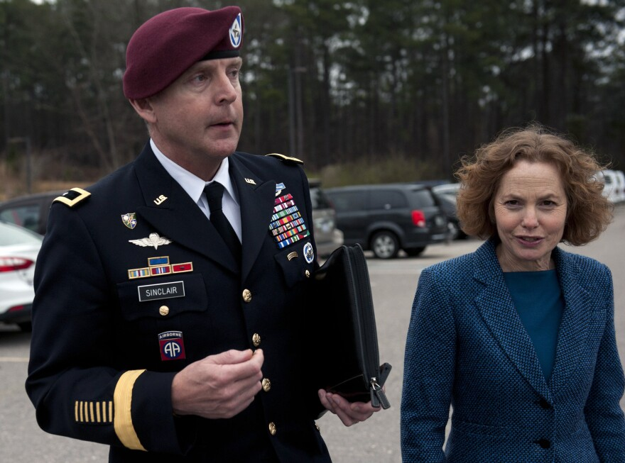 Brig. Gen. Jeffrey Sinclair (L) leaves the Fort Bragg Courthouse with his attorney Ellen Brotman, after sexual assault charges against Sinclair were dropped after he pleaded guilty to lesser charges Monday.