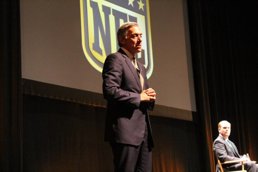 NFL executive Eric Grubman speaks to the crowd.