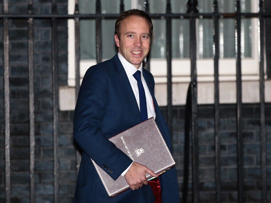 Matt Hancock, the secretary of state for health and social care, leaves the prime minister's residence at No. 10 Downing Street. He was among several members of Prime Minister Theresa May's Cabinet to stop by Tuesday evening to discuss the draft text.