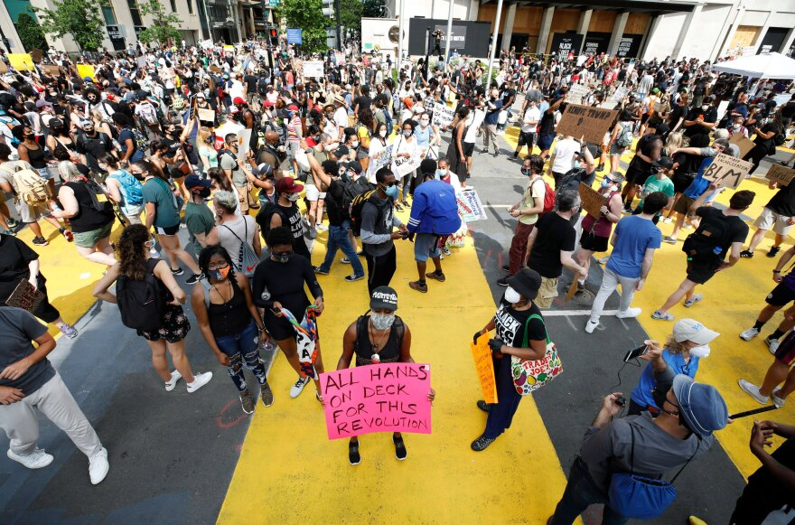 Thousands of protesters demonstrate on the newly minted Black Lives Matter Plaza.