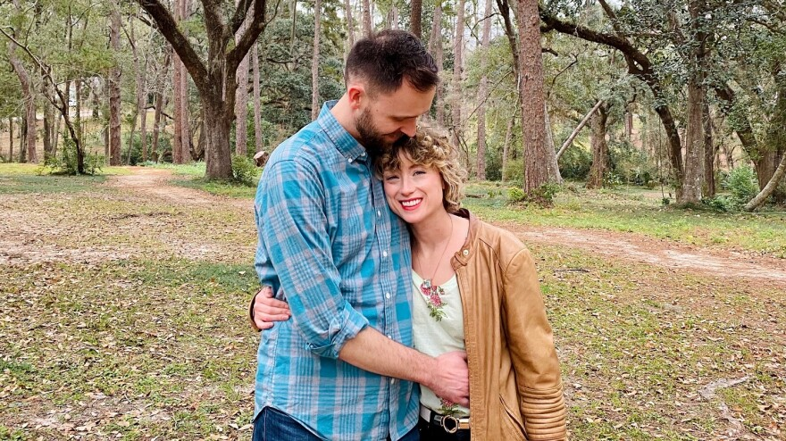 Lawrence Mower and Alexandra Glorioso pose smiling in Tallahassee's Lafayette Park.