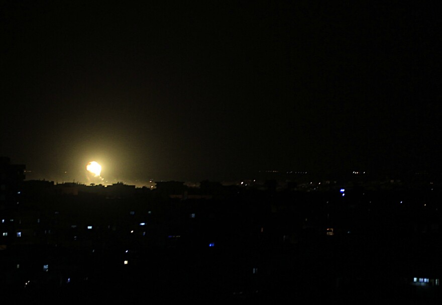 Fire rises from a building during an explosion following an Israeli strike in the town of Rafah in the southern Gaza Strip on Friday.