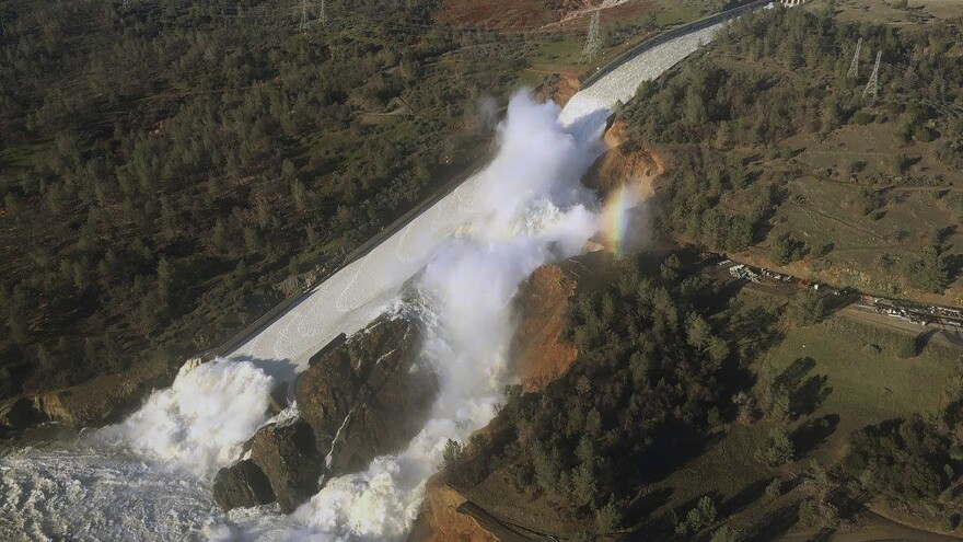 An aerial photo released Saturday by the California Department of Water Resources shows the damaged spillway with eroded hillside in Oroville, Calif.