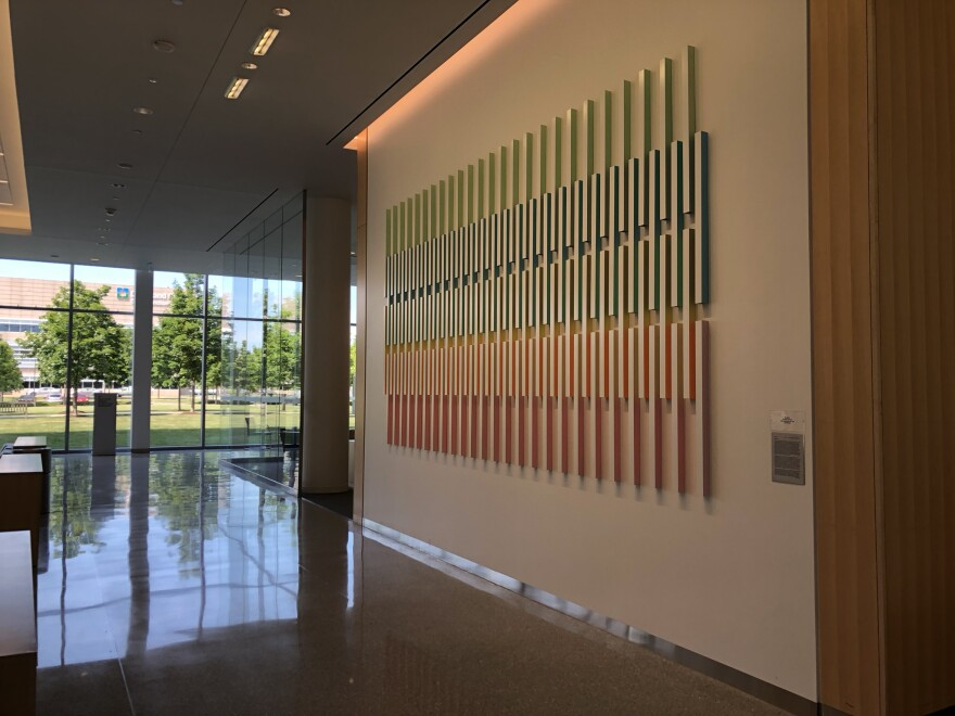 Rana Begum's paint and powder coated aluminium artwork hangs prominently on the first floor of the Clinic's Taussig Cancer Center.