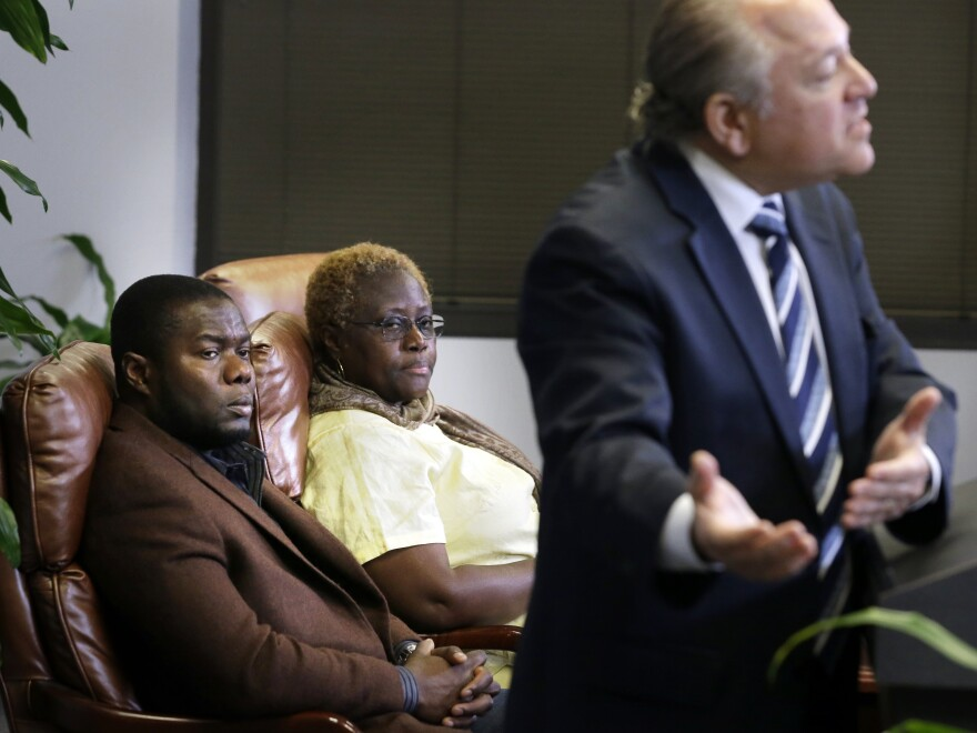 Josephus Weeks, nephew of Thomas Eric Duncan, and Mai Wureh, sister of Duncan, look on as attorney Les Weisbrod speaks during a news conference in Dallas on Wednesday.