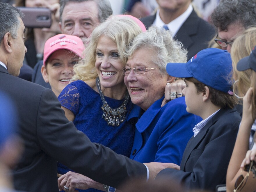 Kellyanne Conway poses with then-Alabama Lt. Gov. Kay Ivey last year. Ivey is now governor and said she's still voting for Roy Moore even though she said she has no reason to disbelieve his accusers.