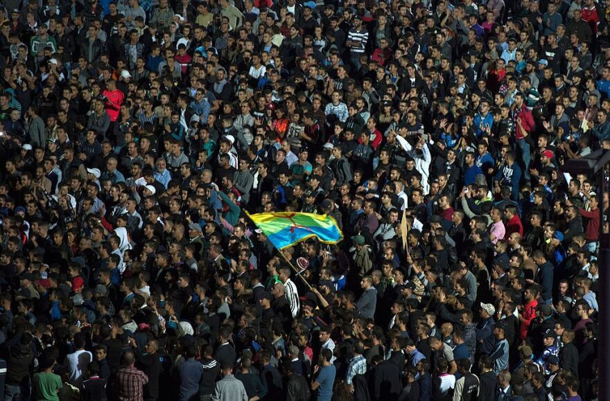 Protesters wave the Amazigh (Berber) flag as they shout slogans in the northern city of al-Hoceima on Sunday after the death of Mouhcine Fikri.