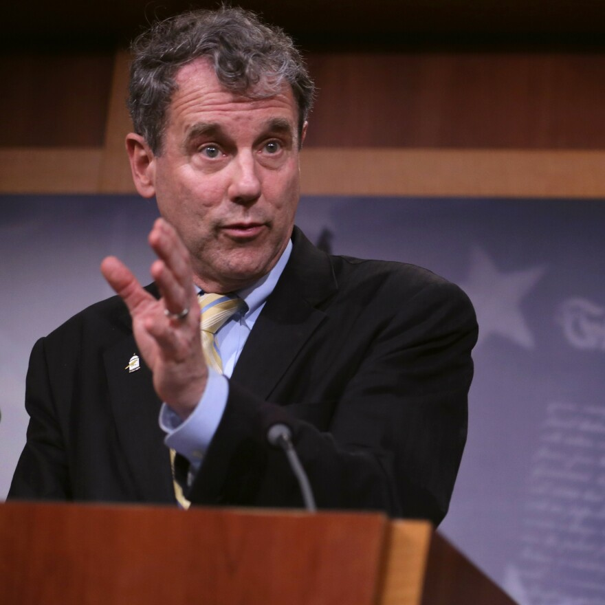 "Sen. Sherrod Brown, seen here speaking about the trade bill Tuesday, told NPR ""I bet that none of my colleagues have read the entire document. I would bet that most of them haven't even spent a couple hours looking at it."" Brown acknowledged he has yet to read every single page of the trade agreement."