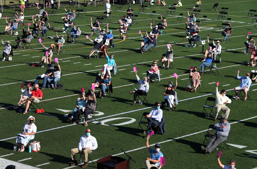 The annual town meeting in North Andover, Mass., which dates back to 1646, was held outside on June 16 on a high school football field to help keep participants a safe distance from each other.