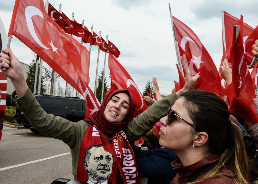 Supporters of Turkish President Recep Tayyip Erdogan wait his arrival to Turkey's capital Ankara on Monday.