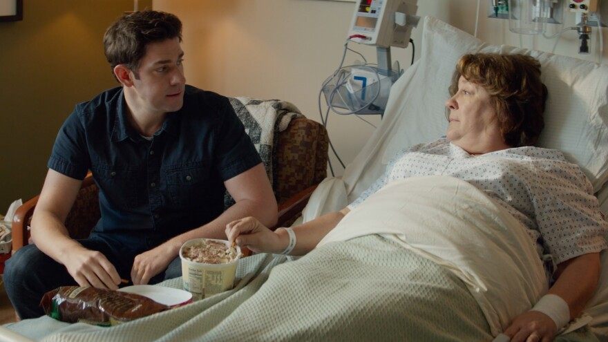 John Krasinski's character returns to his small hometown when his mother (Margo Martindale) is hospitalized with a brain tumor in <em>The Hollars.</em>
