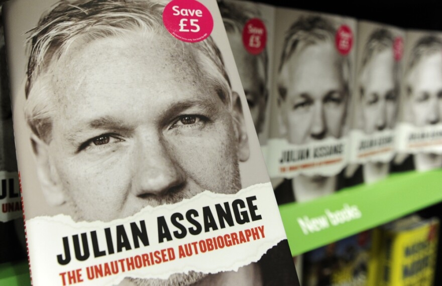 Copies of the book <em>Julian Assange: The Unauthorized Autobiography</em> lined the shelves of a store in central London on Thursday.