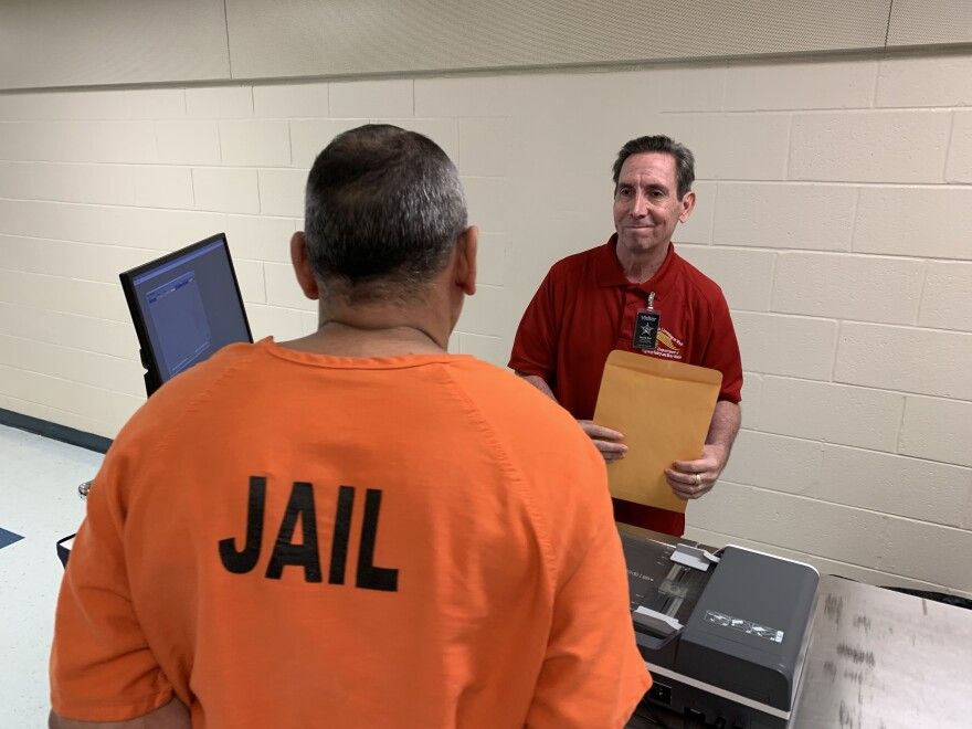 Man in jail garb faces another man