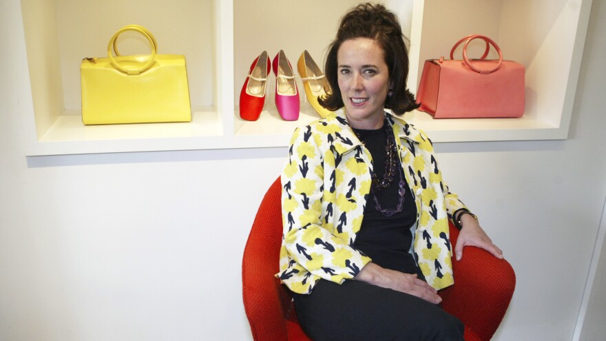 Designer Kate Spade is seen in 2004 among handbags and shoes from her collection. Spade was found dead in her New York City apartment on Tuesday. She was 55.