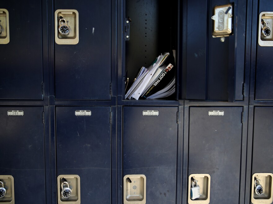 A locker sits open in April at Kent Middle School in Kentfield, Calif. Schools and parents are grappling with whether — and how — to reopen in the fall.