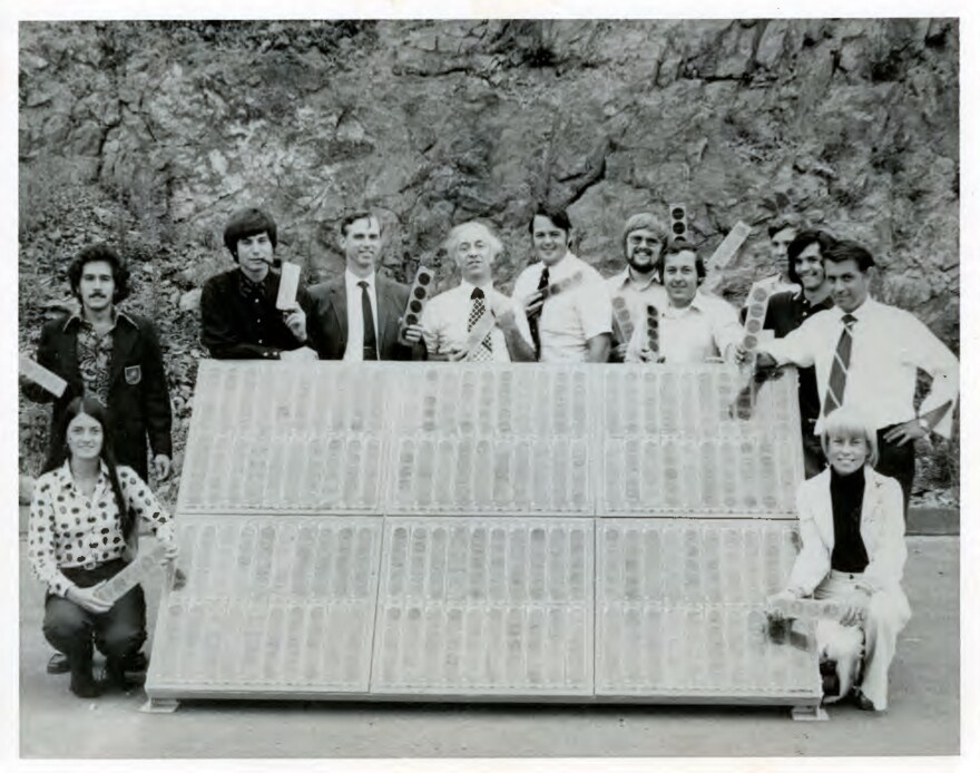 "Elliot Berman (center, in patterned tie) and his team at Solar Power Corp. pose outside their office and manufacturing facility in Braintree, Mass., in 1973. John Perlin, author of <em>Let It Shine: The 6,000-Year Story of Solar Energy,</em> credits Berman, Solar Power Corp. and Exxon with ""planting the flag of photovoltaics throughout the world."""