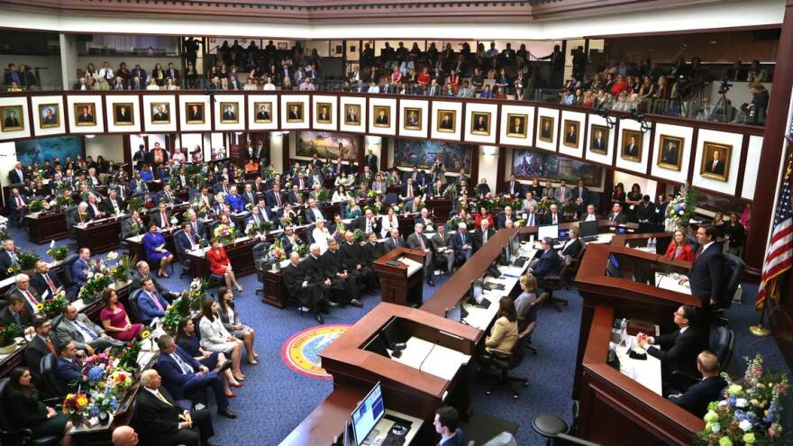 Florida Governor Ron DeSantis, right, addresses a joint session of the Florida Legislature on Tuesday, January 14, 2020.