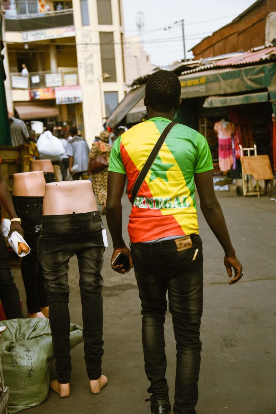 The shirt makes the man: a scene from Dakar's Sandaga Market.