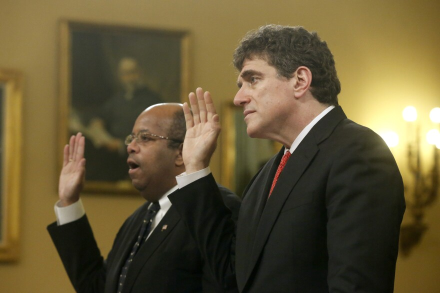 Ousted IRS chief Steve Miller (right) and J. Russell George, a Treasury inspector general, take the oath before testifying on before the House Ways and Means Committee on Friday.