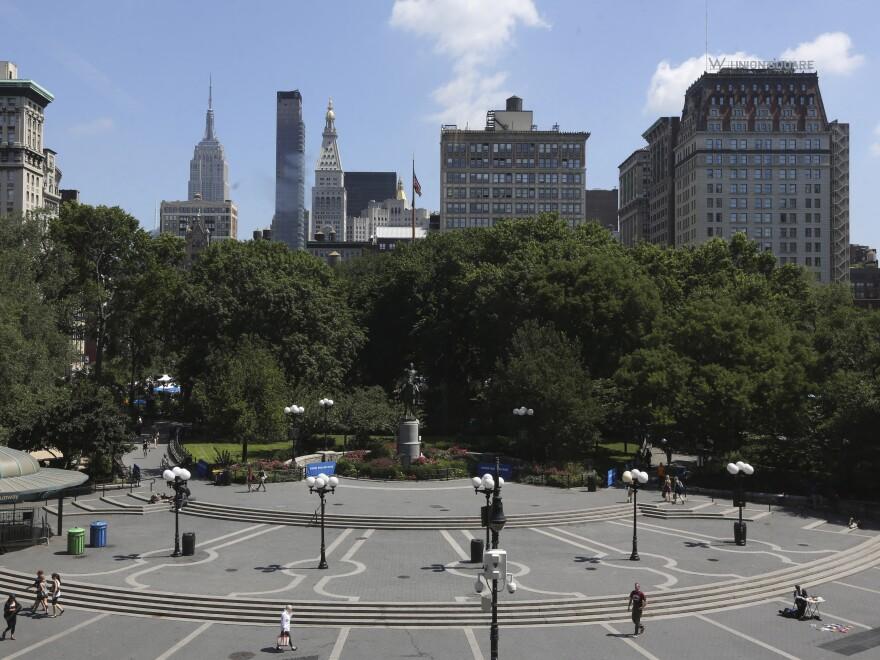 Jeffrey Babbitt was struck by a disturbed man as he walked through Manhattan's Union Square Park, above.