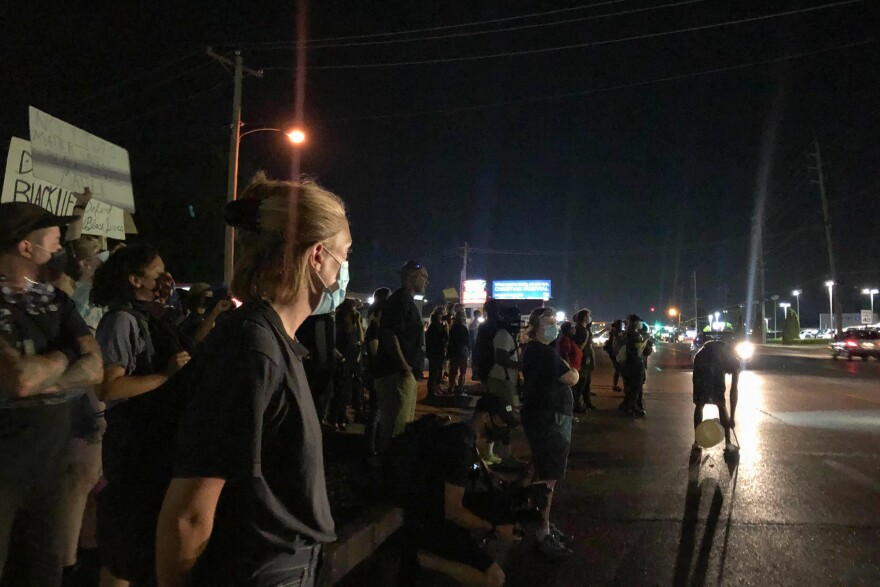 Protesters on Lindbergh Boulevard decry police brutality as they shout at Florissant police on June 21, 2020.