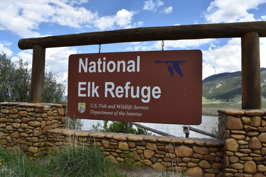 A sign for the National Elk Refuge in Wyoming, overseen by the U.S. Fish and Wildlife Service. The agency was one of four federal land management agencies cited by a GAO report for failing to do enough to protect employees amid rising threats of anti-government violence.