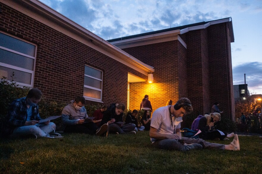 A photo of voters in Provo fill out their ballots during the last hours of the 2020 election.