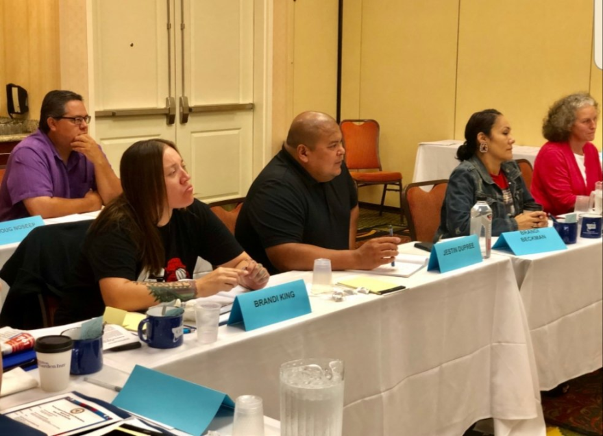 Members of Montana's Missing Indigenous Persons Task Force, including Jestin Dupree and Brandi King, at a meeting in August.