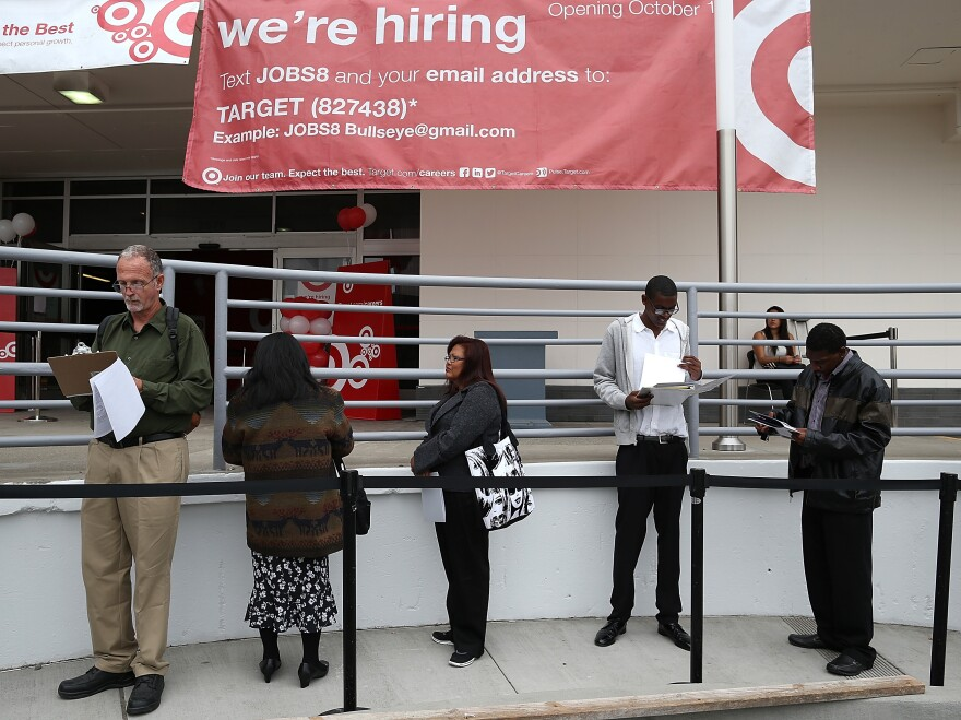 At a Target store in San Francisco last month, job seekers waited in line.