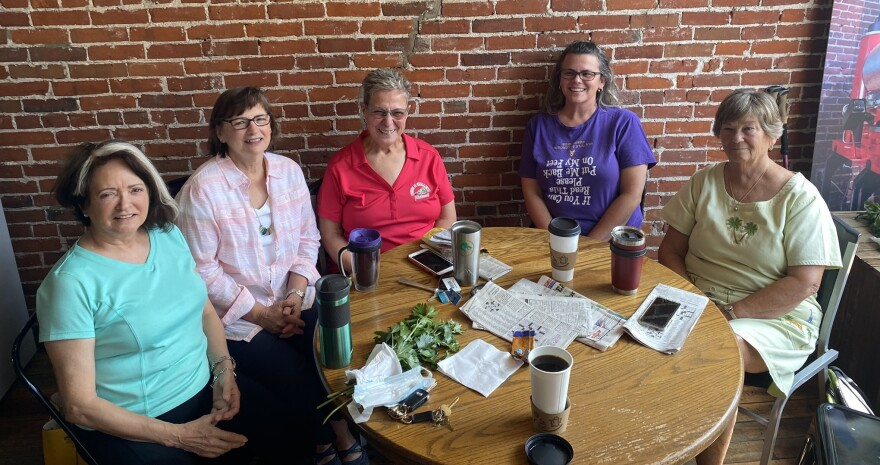 Old friends who meet at Ashtabula's Harbor Perk coffee shop but avoid talking politics because they are divided. From left, Donna Rullo, Valerie Rich, Christine Seuffert, Jolene Salo and Kaye Lind.
