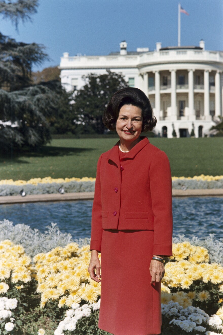lady_bird_johnson__photo_portrait__standing_at_rear_of_white_house__color.jpg