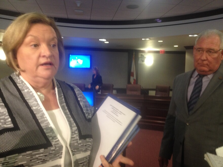 Florida Department of Corrections Secretary Julie Jones speaks to reporters, while Sen. Greg Evers (R-Baker) looks on.