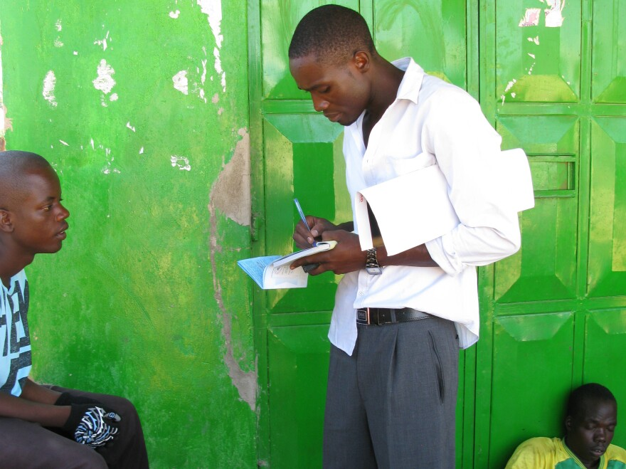 A health worker in western Kenya talks to young men about the benefits of male circumcision.